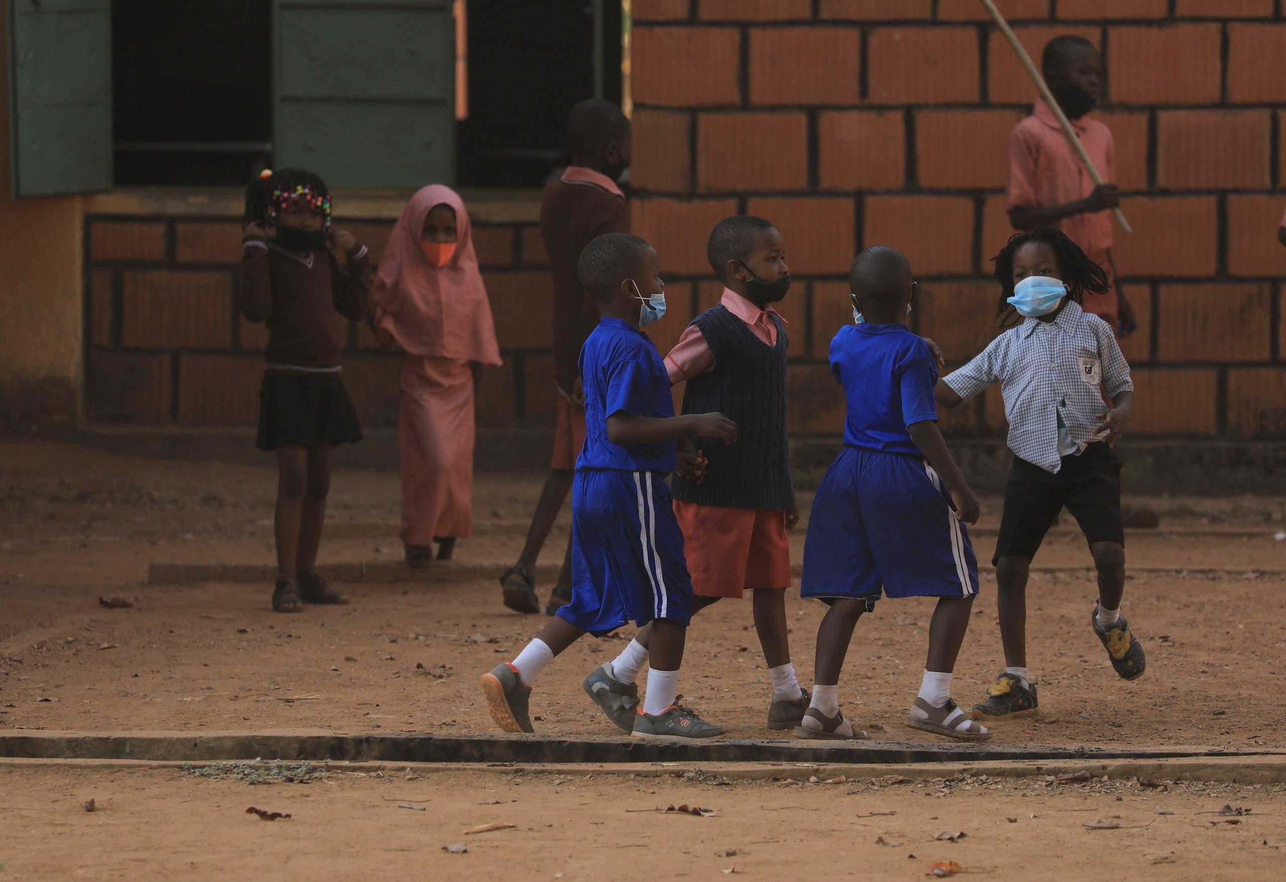 School children play outside as schools reopen in Nigeria amid the coronavirus-disease (COVID-19) outbreak, in Abuja, Nigeria January 18, 2021. (Reuters)