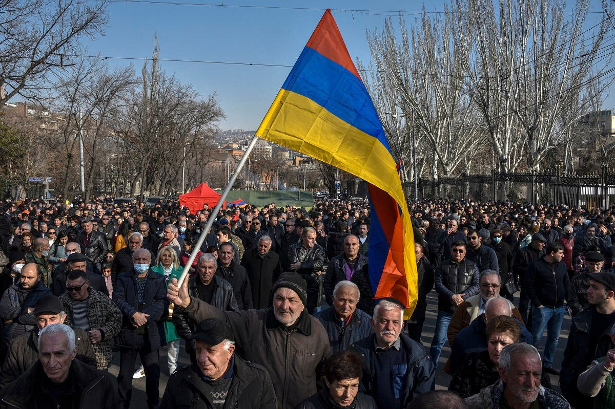 Opposition supporters rally outside the National Assembly building to demand the Prime Minister's resignation over his handling of last year's war with Azerbaijan, in Yerevan on February 27, 2021. (Karen Minasyan/AFP)