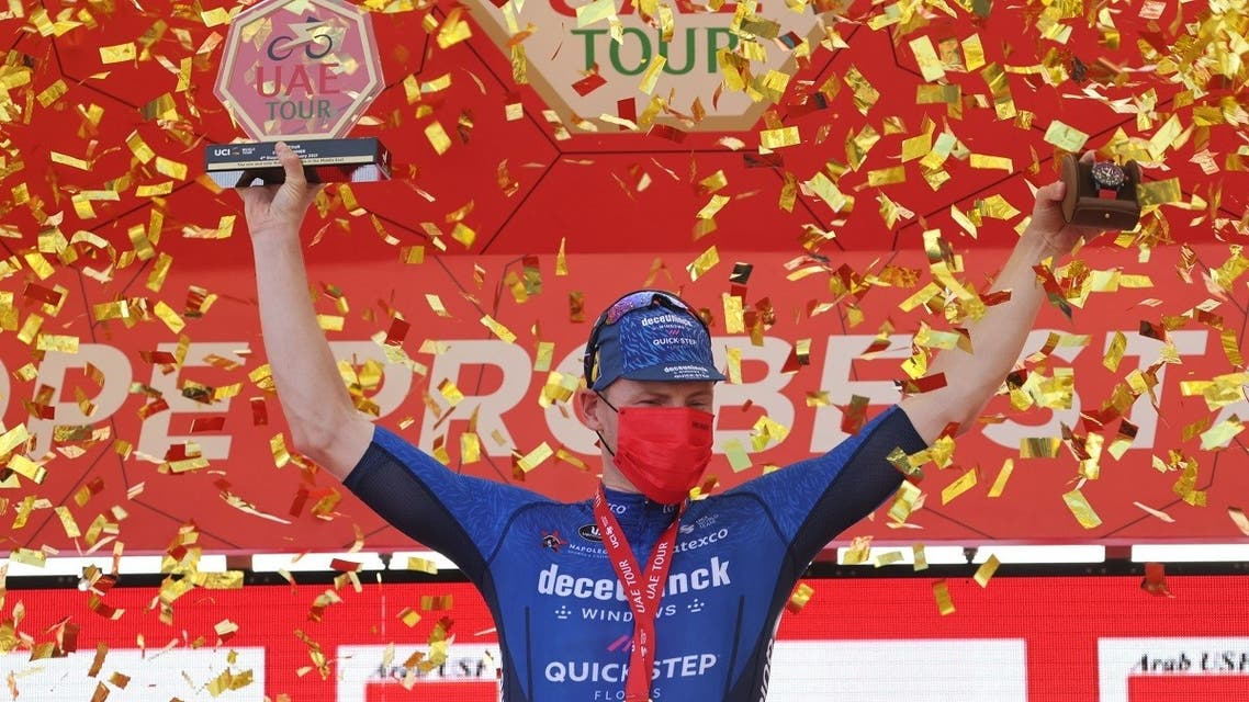 Sam Bennett of Deceuninck Quick Step team stands on the podium after winning the fourth stage of the UAE Cycling Tour at al-Marjan Island on February 24, 2021. (AFP)