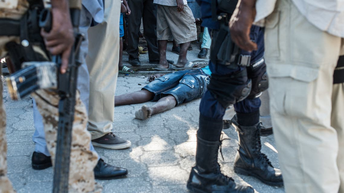 The body of a dead inmate lies on the pavement by the Croix-des-Bouquets prison from where many prisoners escaped and where several people were killed, in Croix-des-Bouquets, suburb of the Haitian capital, on February 25, 2021. Multiple people were killed February 25 in Haiti, including the director of a prison in the suburbs of capital Port-au-Prince, after several inmates escaped, police said. (File photo: AFP)