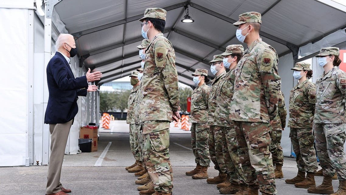 US President Joe Biden addresses troops from a medical unit who are helping to run a vaccination site for the coronavirus disease in, Texas, Feb. 26, 2021. (Reuters)