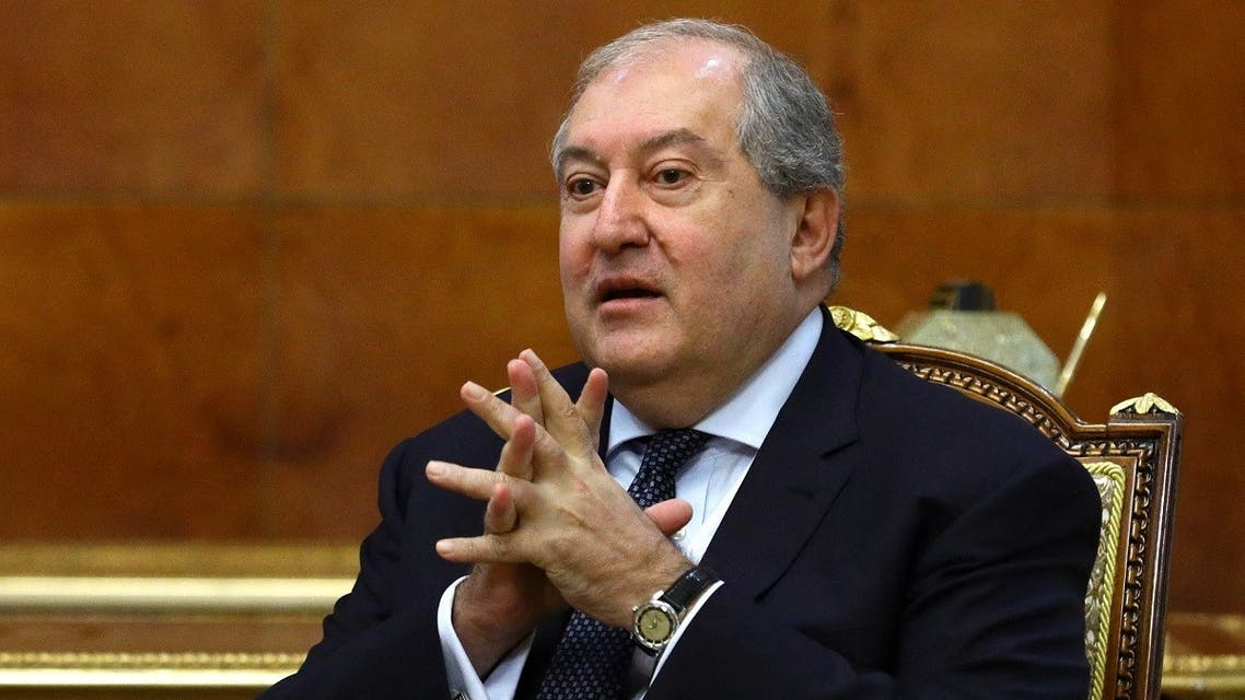 This handout photograph taken and released on November 21, 2020 shows Armenian President Armen Sarkissian speaking with the Russian Foreign Minister (unseen) during their meeting in Yerevan, Armenia. (Russian Foreign Ministry/AFP)