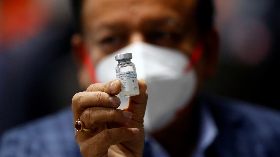 Indian Health Minister Harsh Vardhan holds a dose of Bharat Biotech's COVID-19 vaccine called COVAXIN, Jan. 16, 2021. (Reuters)