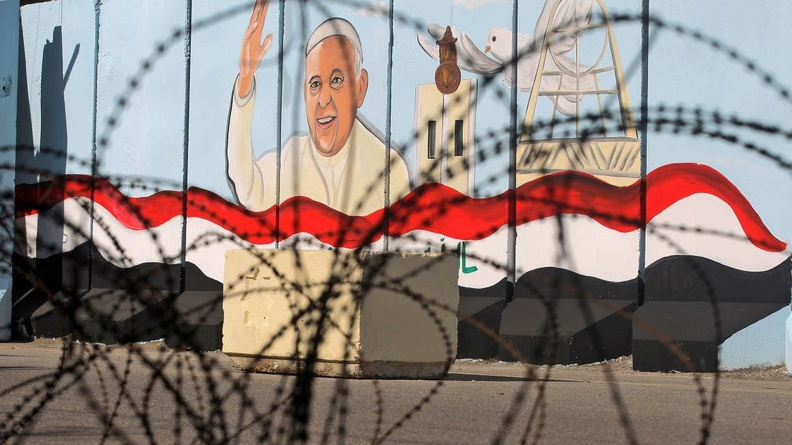A mural depicting Pope Francis is pictured on the outer walls of Our Lady of Salvation (Sayidat al-Najat) Church in the Iraqi capital Baghdad, on February 22, 2021. (Ahmad al-Rubaye/AFP)