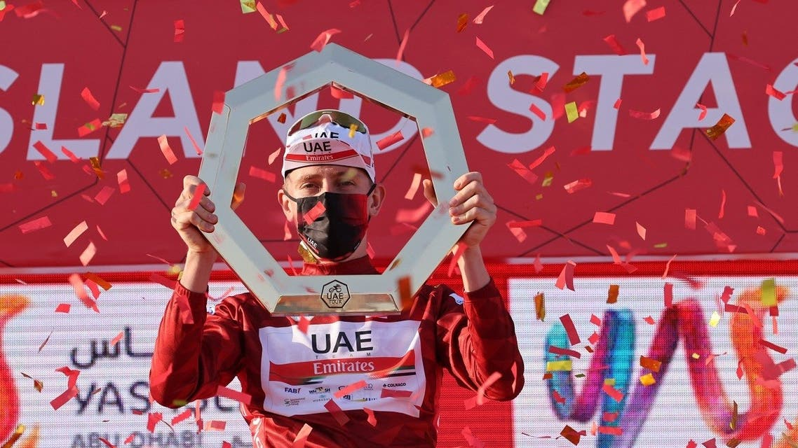 Tadej Pogacar of Team UAE Emirates celebrates on the podium after winning the UAE Cycling Tour from Yas Mall to Abu Dhabi Breakwater, on February 27, 2021. (AFP)