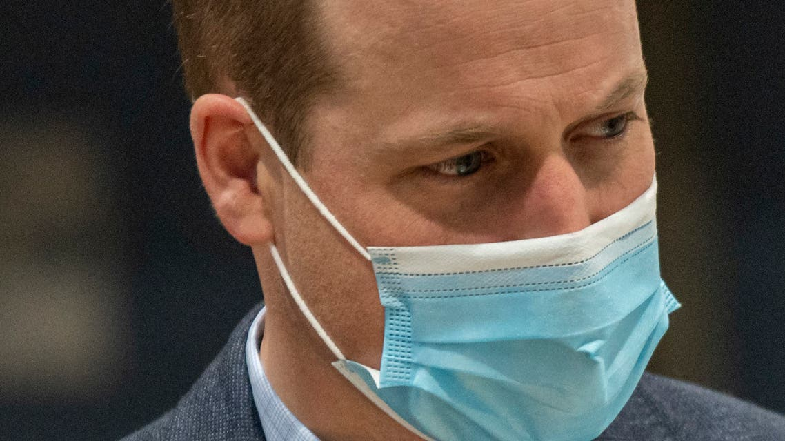 Britain's Prince William, Duke of Cambridge wears a face mask because of the pandemic as he visits a coronavirus vaccination centre at King's Lynn Corn Exchange in King's Lynn, eastern England, on February 22, 2021. AFP