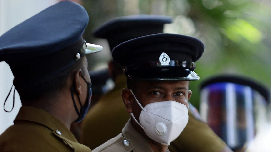 Sri Lankan police personnel stand along a road in Colombo on January 26, 2021. (File photo: AFP)