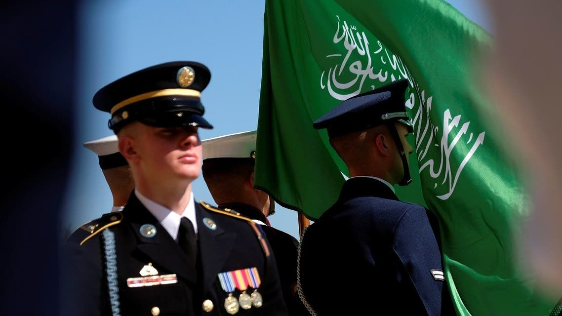 The flag of the Kingdom of Saudi Arabia flies in the face of a member of a US military honor guard at the Pentagon, Aug. 29, 2019. (Reuters)