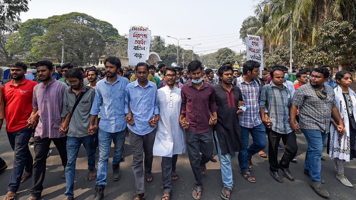 Activists from the left parties participate in a protest march during a demonstration in Dhaka on March 1, 2021, following the death of writer Mushtaq Ahmed in jail months after his arrest. (AFP)