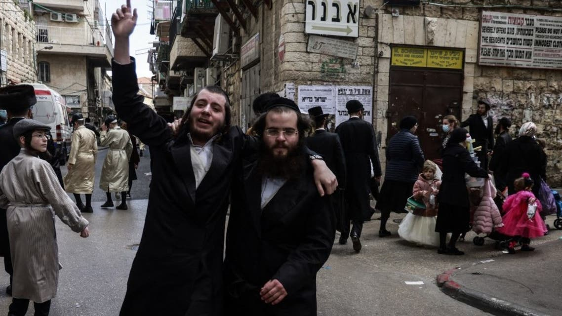 Orthodox Jewish men, are pictured during Purim celebrations,in the neighbourhood of Mea Shearim in Jerusalem, on February 28, 2021. (AFP)