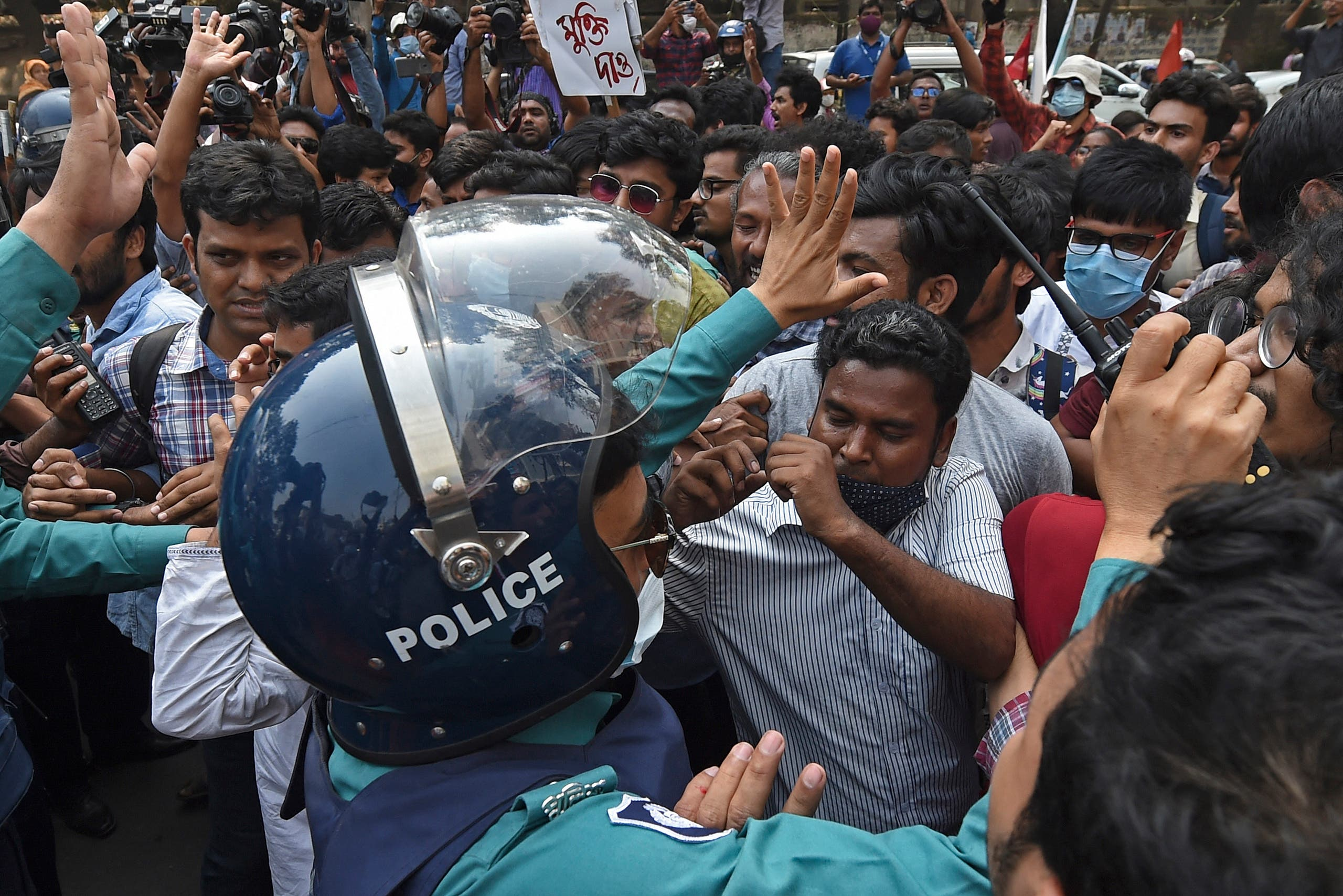 Activists from the left parties scuffle with the police during a demonstration in Dhaka on March 1, 2021, following the death of writer Mushtaq Ahmed in jail months after his arrest. (AFP)
