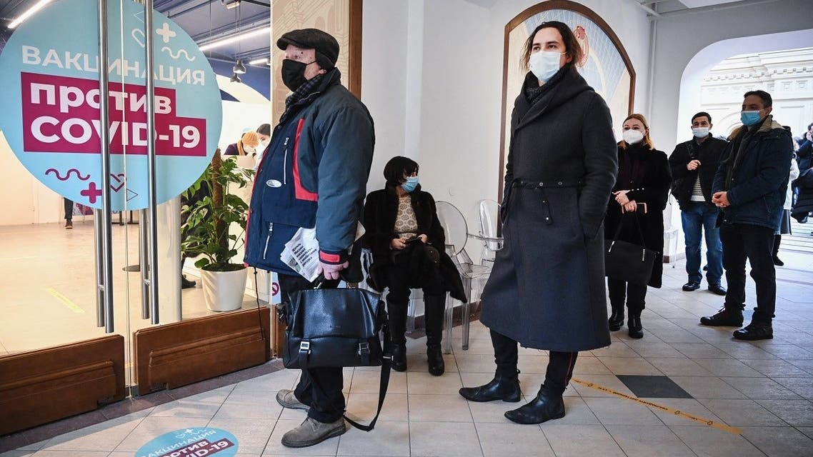 People queue to receive an injection of Russia's Sputnik V (Gam-COVID-Vac) vaccine against the coronavirus at a vaccination point at the GUM department store in Moscow on January 18, 2021. (Alexander Nemenov/AFP)