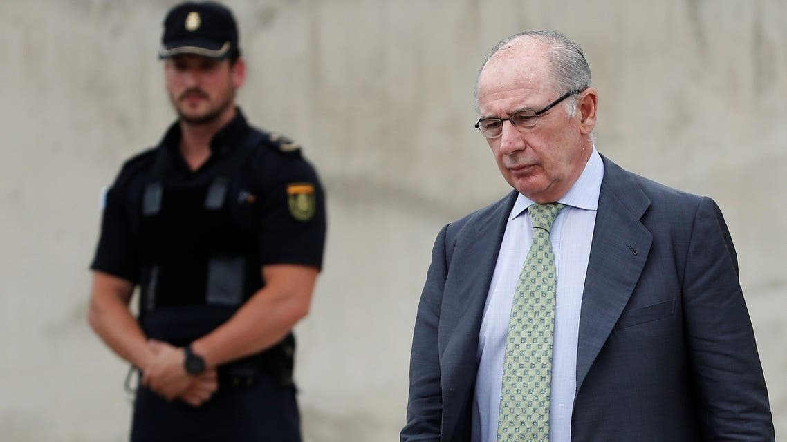 A file photo shows former IMF chief Rato leaves after standing as a witness in the Gurtel corruption case at High Court in San Fernando de Henares, outside Madrid, Spain June 20, 2017. (Reuters/Susana Vera)