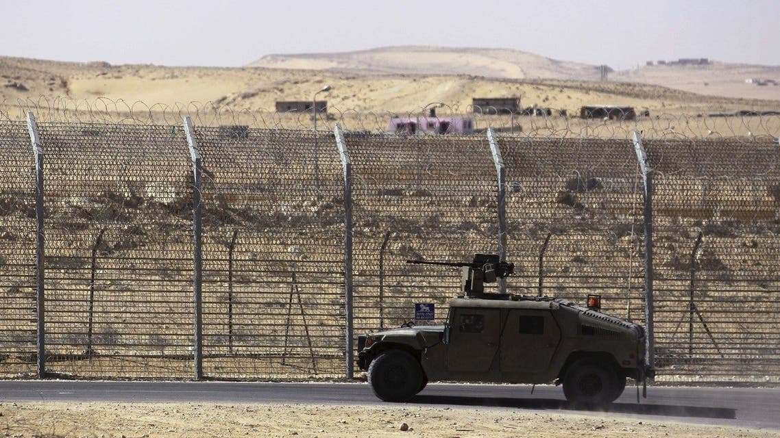 An armored Israeli military vehicle drives along Israel's border with Egypt's Sinai peninsula, near the Nitzana crossing in this picture taken January 30, 2014. (Reuters/Amir Cohen)