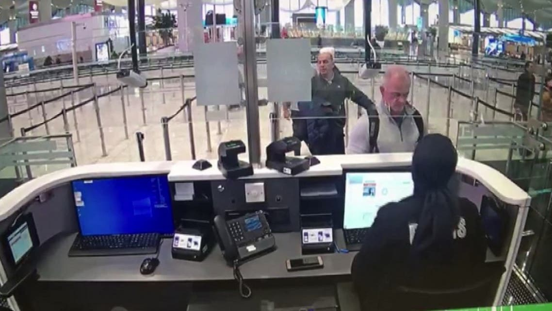 This handout video grab image released by The Istanbul Police Department on January 17, 2020, shows Michael Taylor (2R) and George Antoine Zayek (C) at passport control in Istanbul Airport, two men accused of helping fugitive businessman Carlos Ghosn escape via an Istanbul airport, as he fled a corruption trial in Japan. (AFP)