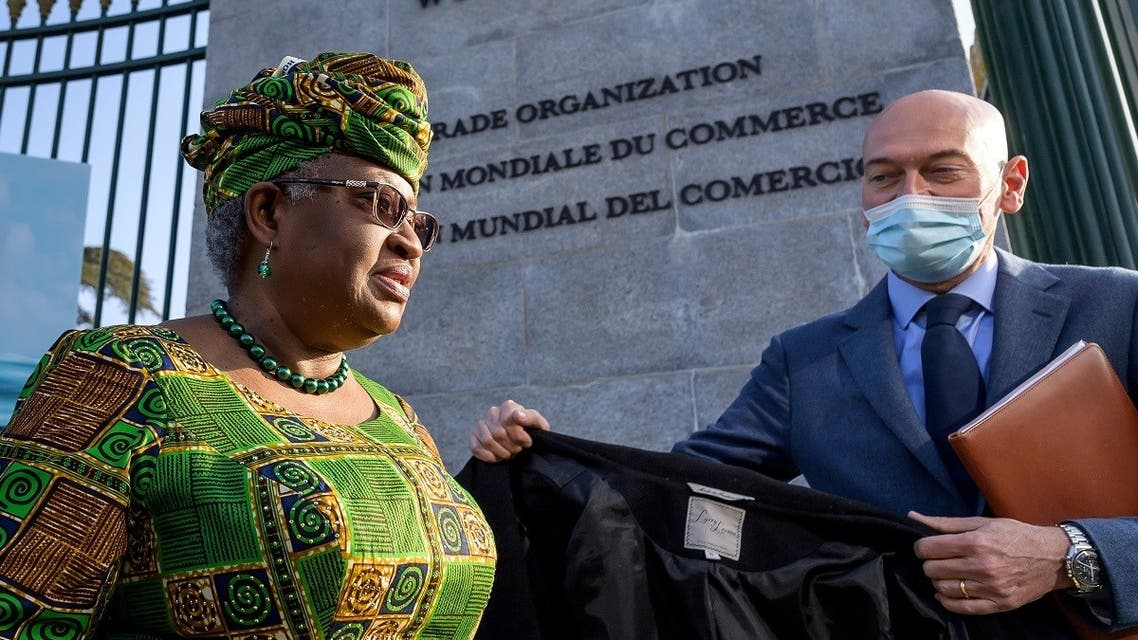 New Director-General of the World Trade Organisation Ngozi Okonjo-Iweala walks at the entrance of the WTO following a photo-op upon her arrival at the WTO headquarters to take an office in Geneva, Switzerland, on March 1, 2021. (Reuters)