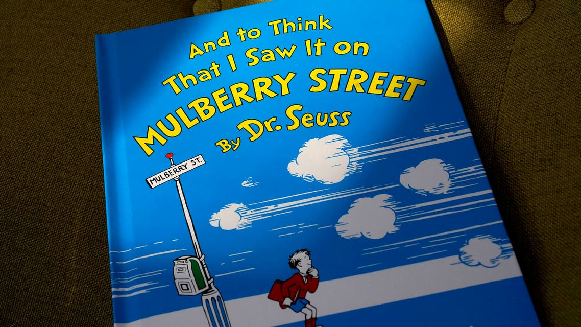 A copy of the book And to Think That I Saw It on Mulberry Street, by Dr. Seuss, rests in a chair, Monday, March 1, 2021, in Walpole, Massachussetts, US. (AP)