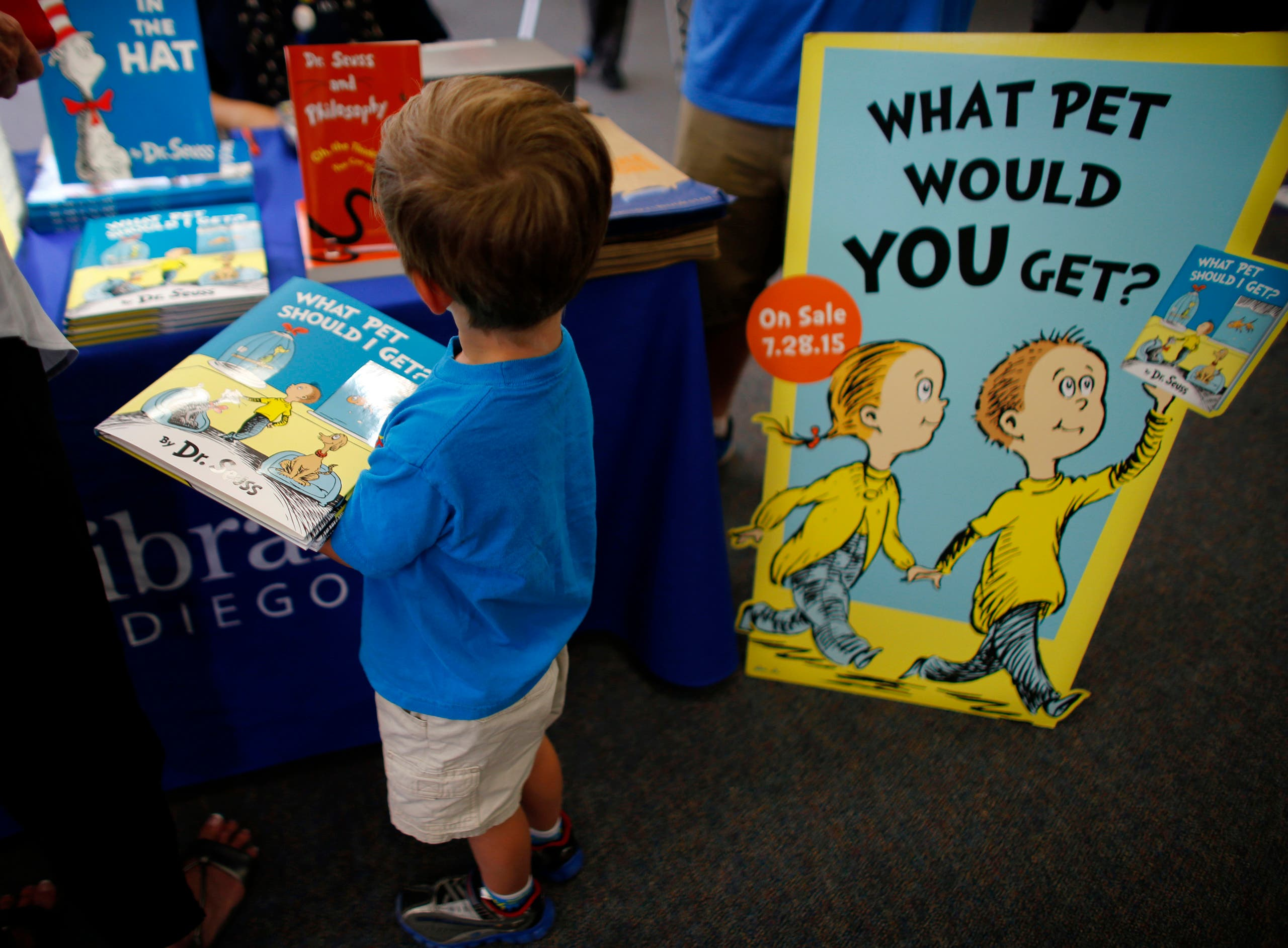 Three year-old Justin Jilka holds his new copy during the release of the Dr. Seuss book What Pet Should I Get? at the University of California San Diego's Geisel Library in San Diego, California July 28, 2015. (Reuters)