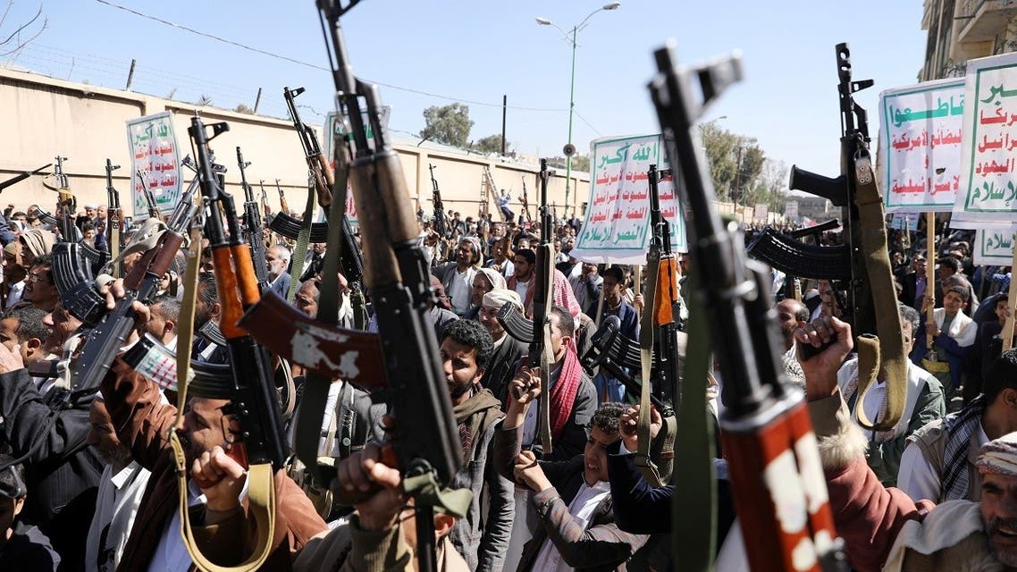 Houthi supporters hold up their weapons during a demonstration against the US decision to designate the Houthis as a foreign terrorist organization, in Sanaa, Jan. 20, 2021. (Reuters)