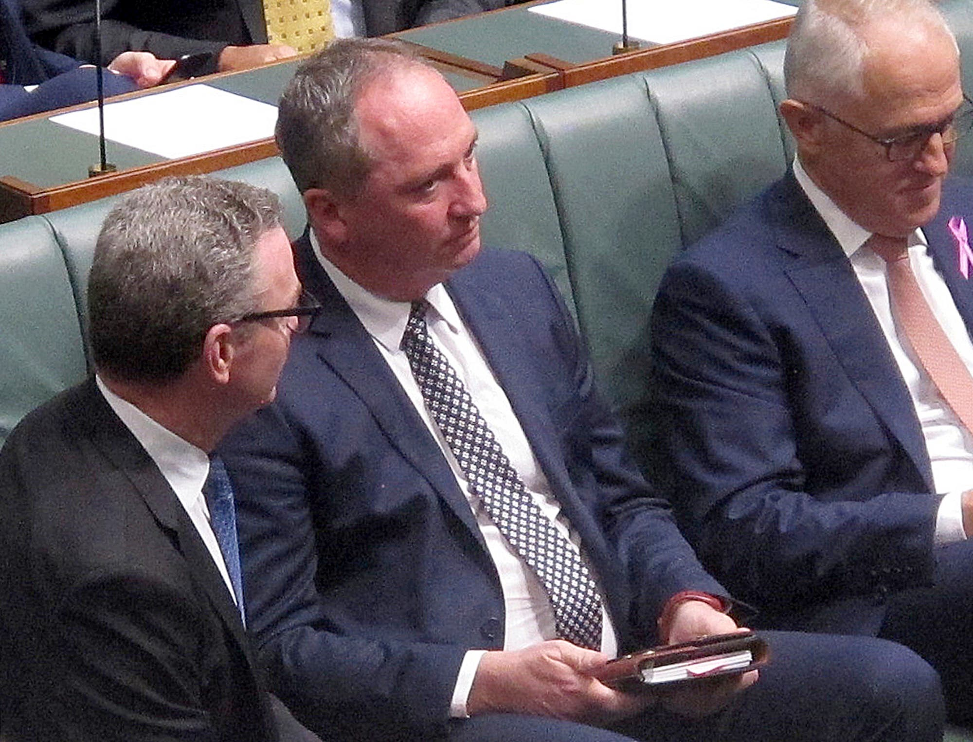 Former deputy Prime Minister Barnaby Joyce (center) ran into political strife in 2018 over revelations that he had impregnated a female staffer, who is now his partner, in an extramarital affair. (AP)