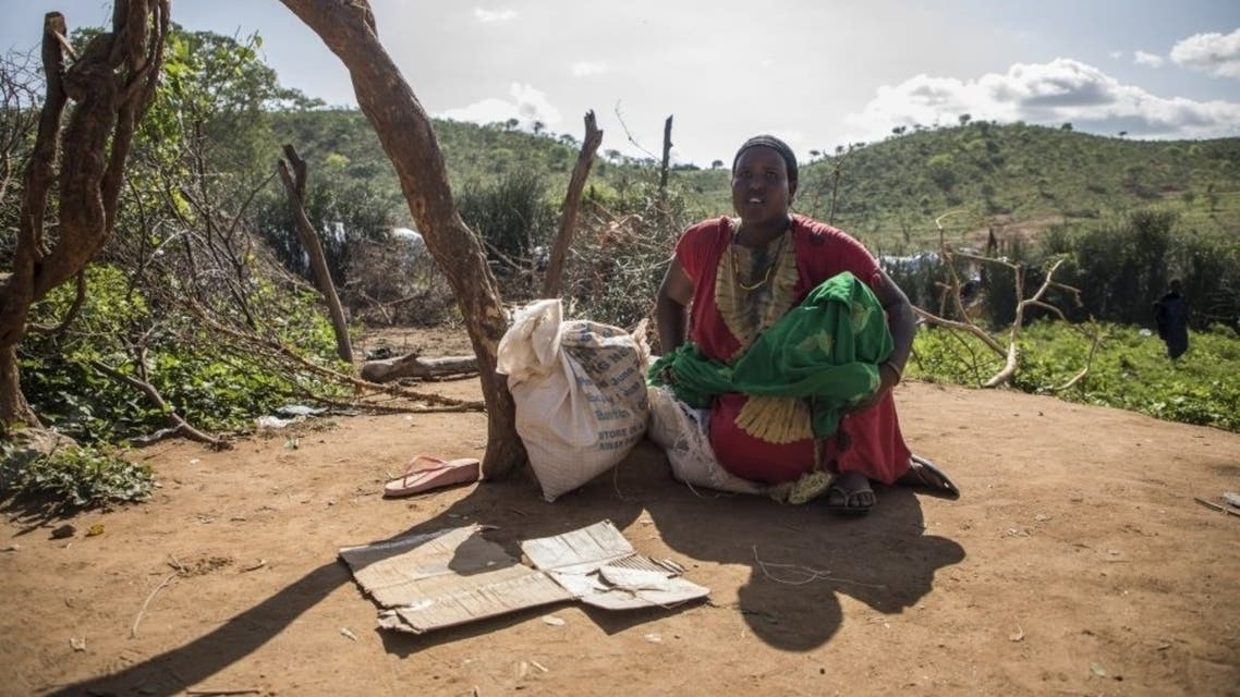 A refugee from Ethiopia sits next to a bag of rice donated by Kenyan officials at a camp in Moyale, Marsabit County, Kenya. (Courtesy UNHCR/Will Swanson)