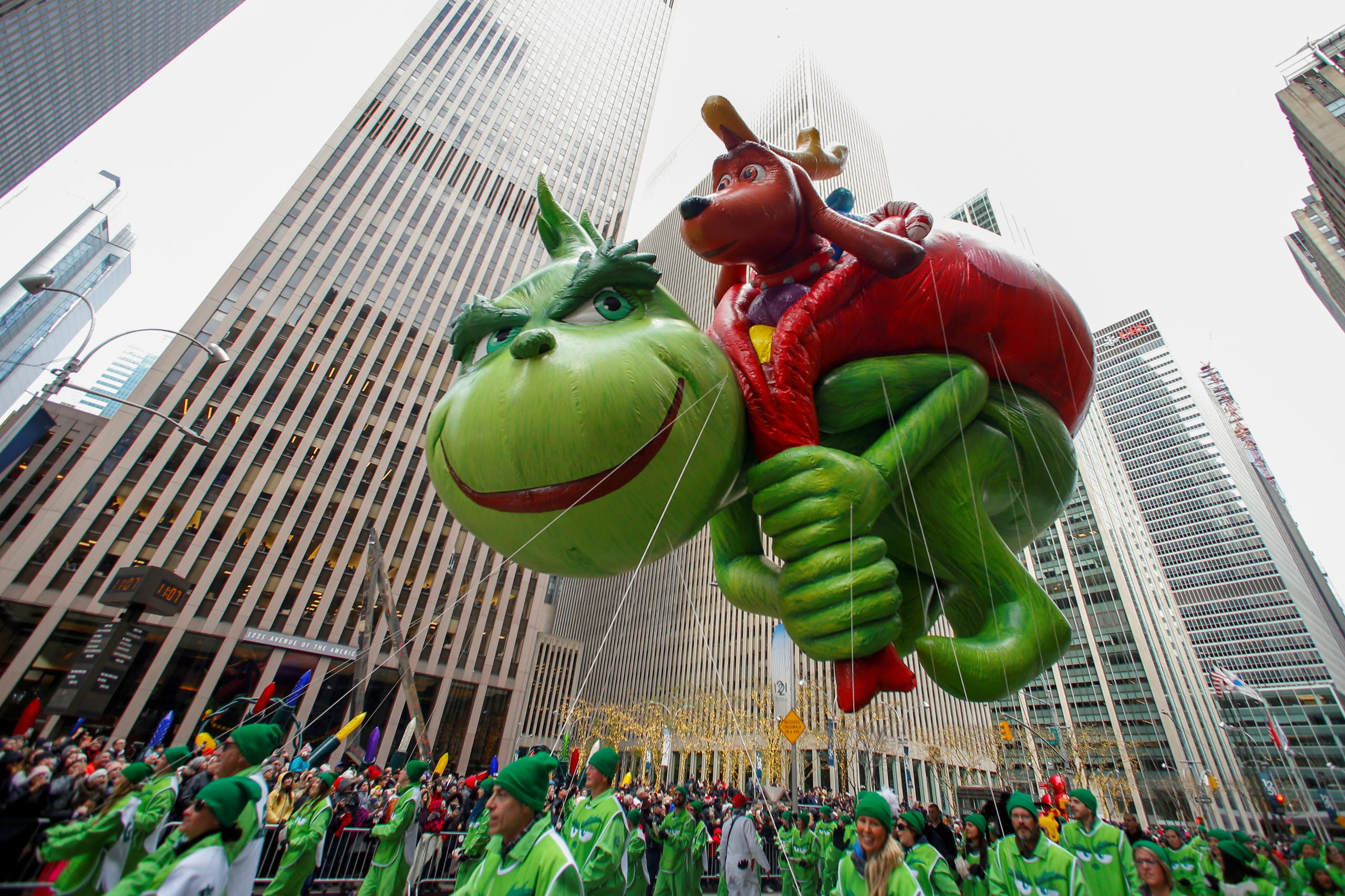 The Dr Seuss' The Grinch balloon is carried during the 93rd Macy's Thanksgiving Day Parade in New York, US, November 28, 2019. (Reuters)