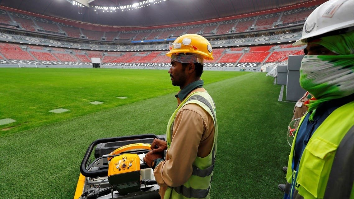 Workers are seen inside Al Bayt stadium, built for the upcoming 2022 FIFA World Cup. (Reuters)