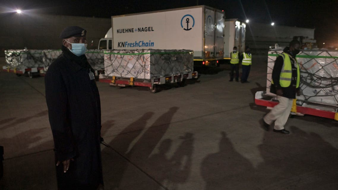 A police officer stands by as the first batch of Covid-19 vaccines are unloaded at The Jomo Kenyatta International Airport, in Nairobi on March 3, 2021. (AFP)