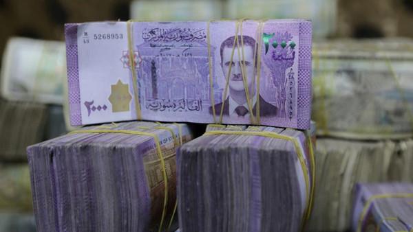شامی کرنسی کی قیمت ڈالر کے مقابلے میں 99 فی صد گر گئی