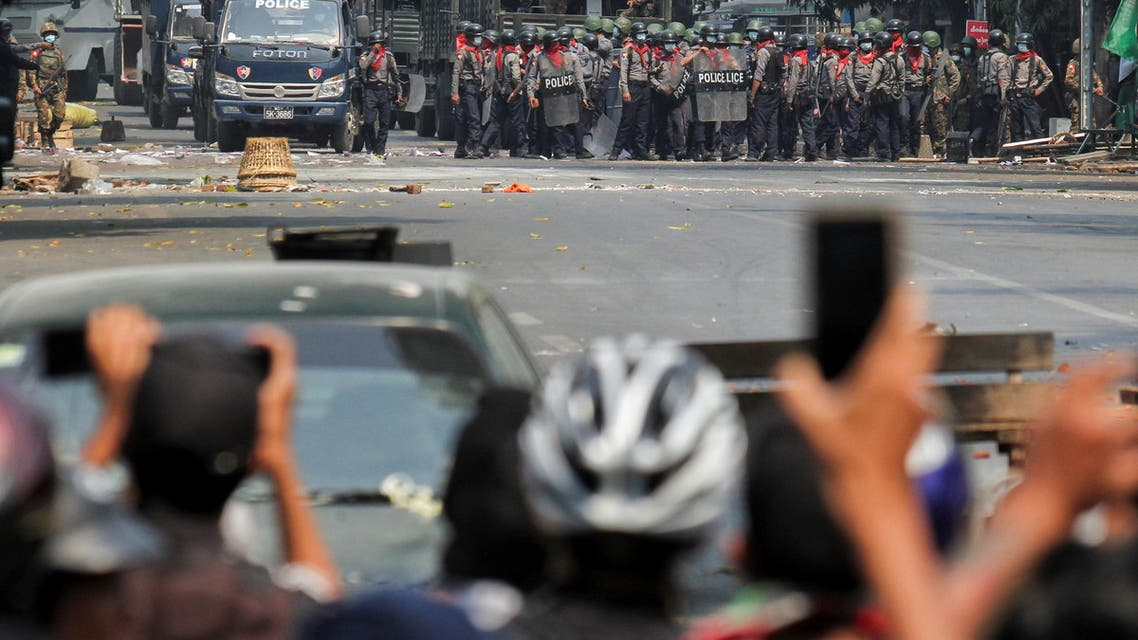 Police stand on a road during an anti-coup protest in Mandalay, Myanmar, March 3, 2021. (Reuters)