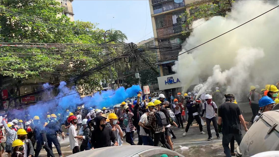 Protesters set off smoke grenades to block the view from snipers in Sanchaung, Yangon, Myanmar March 3, 2021, in this still image from a video obtained by Reuters. Video obtained by REUTERS. ATTENTION EDITORS - THIS IMAGE HAS BEEN SUPPLIED BY A THIRD PARTY. NO RESALES. NO ARCHIVES.