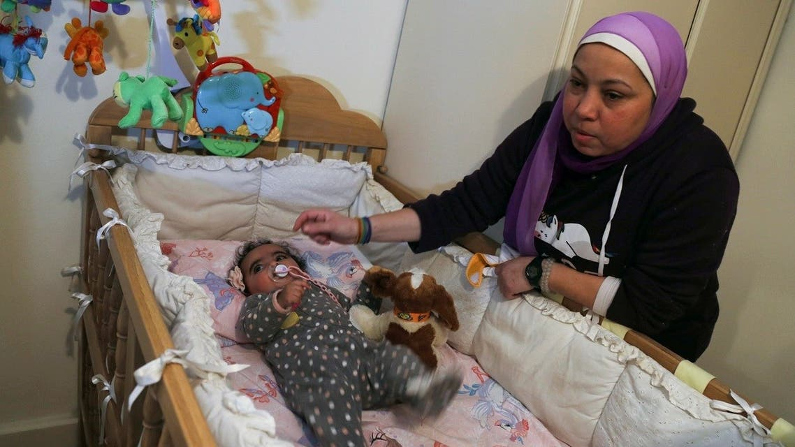 Yasmina al-Habbal, sits next to her Ghlaya, an orphan she sponsors, at her home in Cairo, Egypt February 22, 2021. Picture taken February 22, 2021. (Reuters/Hanaa Habib)
