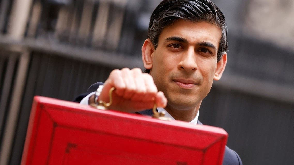 Britain's Chancellor of the Exchequer Rishi Sunak holds the budget box outside Downing Street in London, Britain, on March 3, 2021. (Reuters)