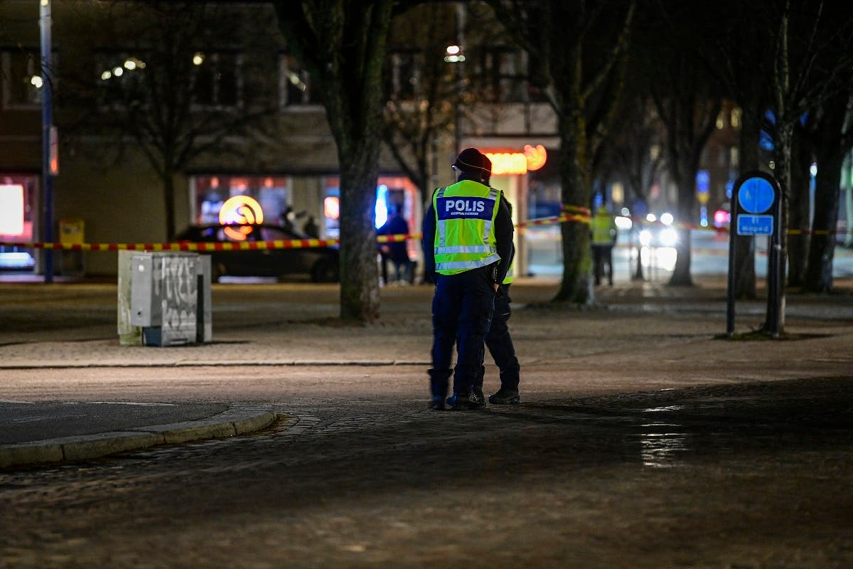 Police have cordoned off the scene where a man attacked eight people with a sharp weapon, seriously injuring two, in the Swedish city of Vetlanda on March 3, 2021. (AFP)