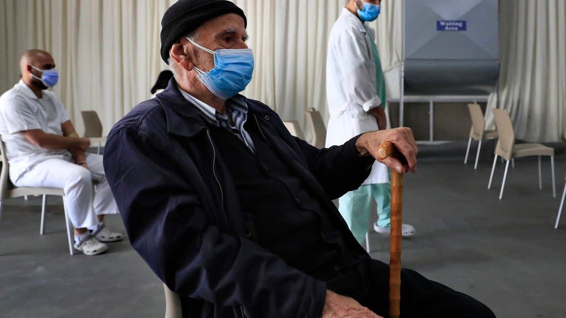 A man waits his turn to receive the Pfizer-BioNTech COVID-19 vaccine during a nationwide vaccination campaign, at the Saint George Hospital, in Beirut, Lebanon. (File photo: AP)