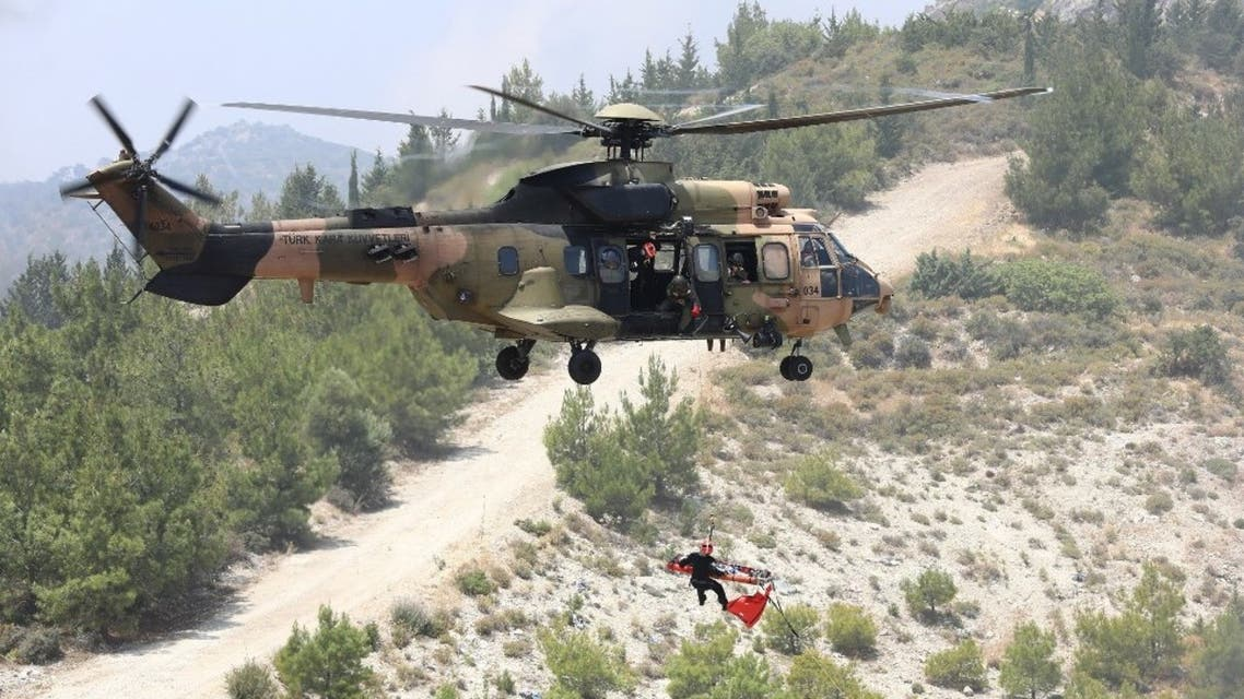 A Turkish army's Eurocopter AS532 Cougar helicopter takes part in a military rescue mission exercise in the northern part of the Mediterranean island of Cyprus in the self-proclaimed Turkish Republic of Northern Cyprus, on June 11, 2019. (AFP)