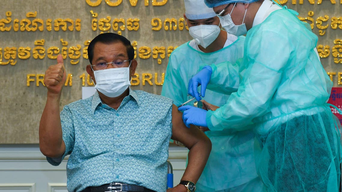 Cambodian Prime Minister Hun Sen gestures as he receives the AstraZeneca vaccine during a vaccination campaign against the Covid-19 coronavirus at Calmette hospital in Phnom Penh on March 4, 2021. (AFP)