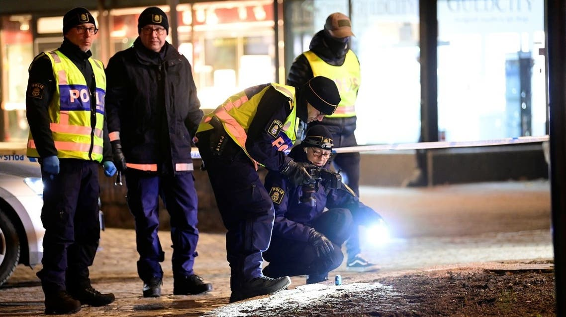 Police forensics team members work at a knife attack site where several people were injured before the suspect was shot by police and taken into custody in Vetlanda, Sweden March 3, 2021.  (Reuters)