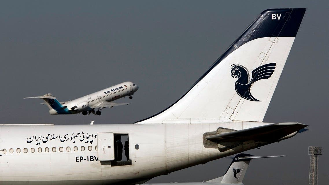 An Iranian Aseman Airlines' Fokker 100 takes off as an Iran Air aircraft is seen in the foreground at Tehran's international airport. (File photo: Reuters)