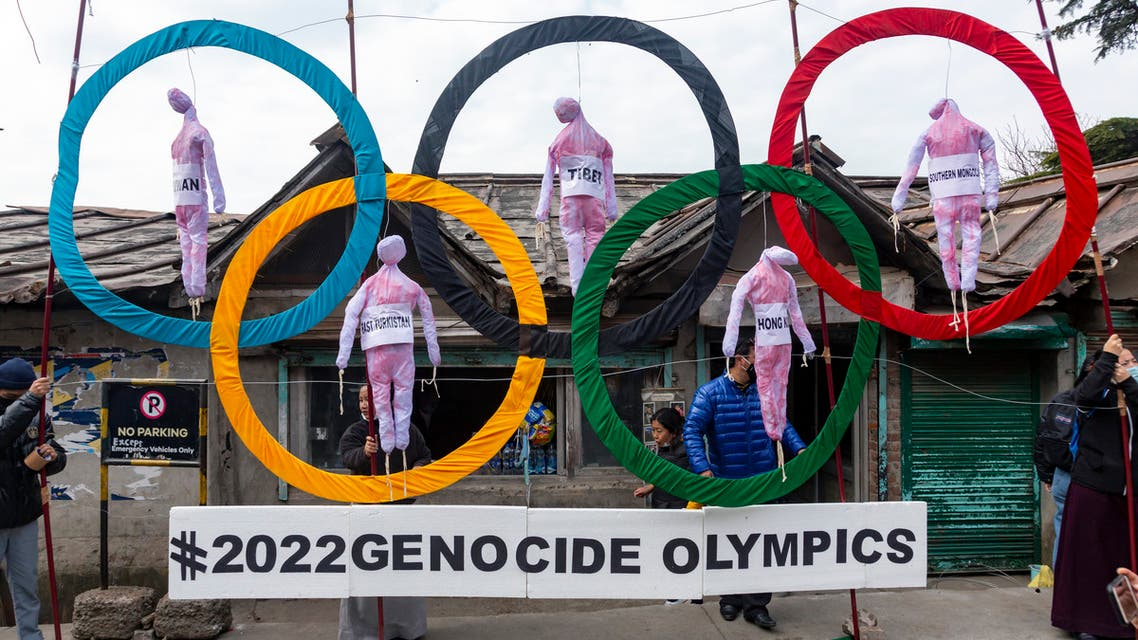 Exile Tibetans use the Olympic Rings as a prop as they hold a street protest against the holding of 2022 Winter Olympics in Beijing in Dharmsala, India, Wednesday, Feb. 3, 2021. (File photo: AP)