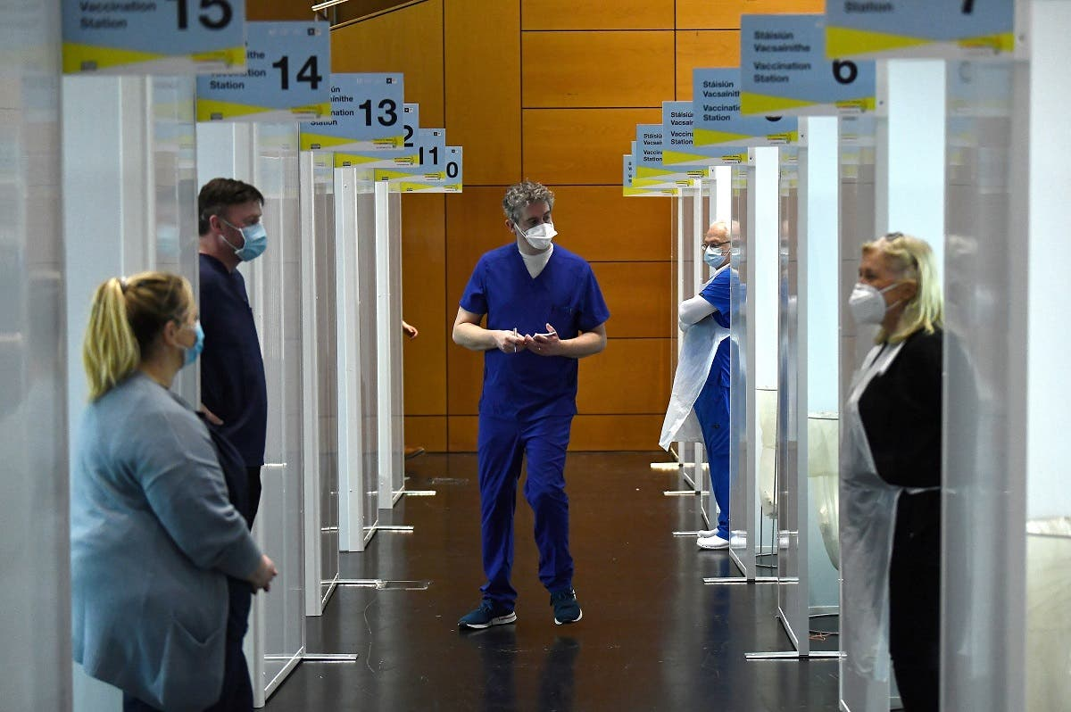 Doctors wait at their vaccination booths, amid the outbreak of the coronavirus in Dublin, Ireland Feb. 20, 2021. (Reuters)