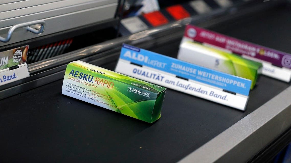 COVID-19 rapid tests are seen on a checkout belt in an ALDI Nord store in Essen, western Germany, on March 05, 2021. (Leon Kuegeler/AFP)
