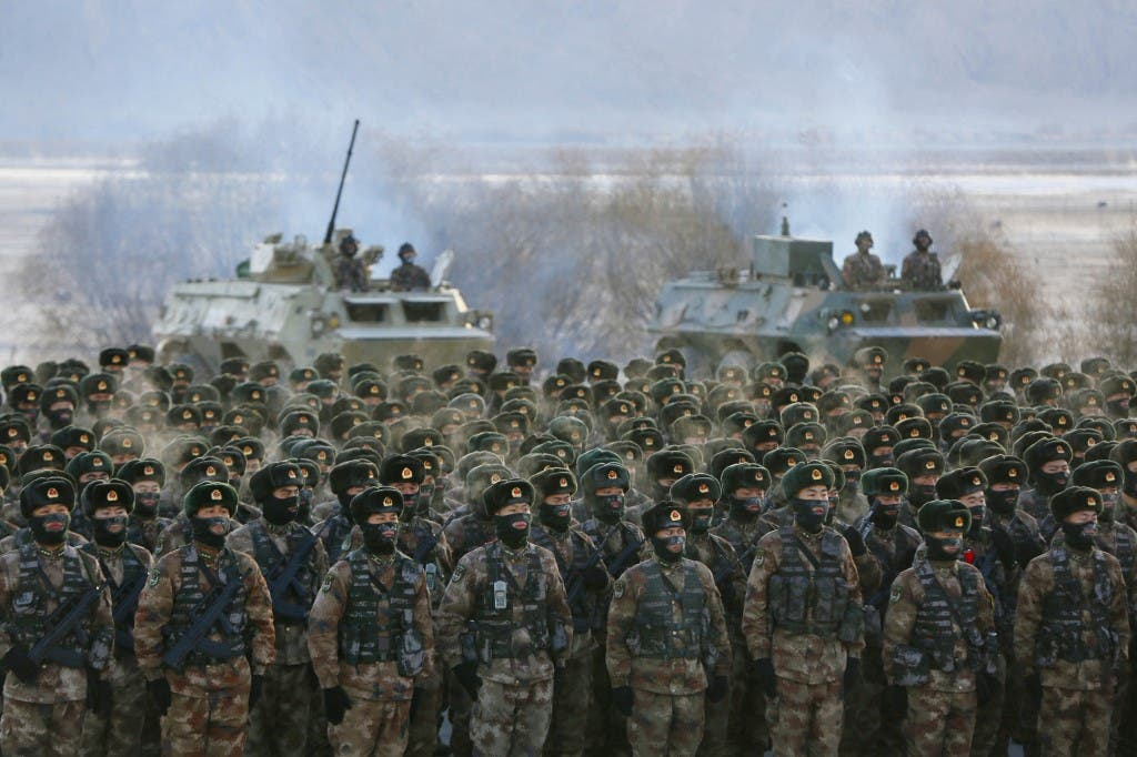 This photo taken on January 4, 2021 shows Chinese People's Liberation Army (PLA) soldiers assembling during military training at Pamir Mountains in Kashgar, northwestern China's Xinjiang region. (AFP)
