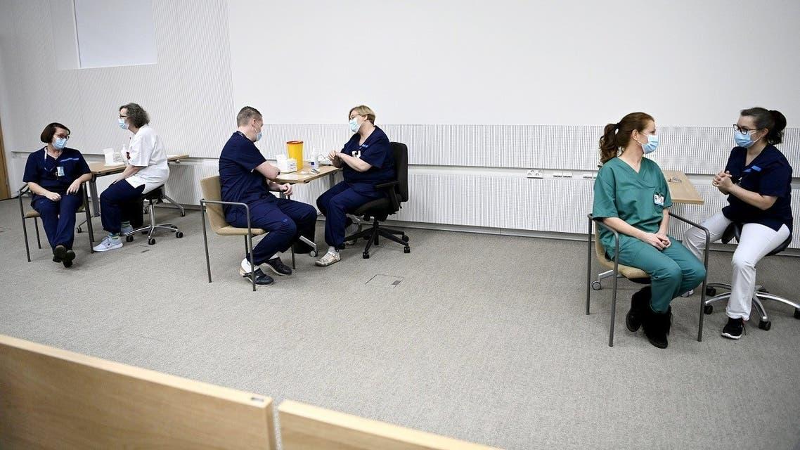 Medics receive the Pfizer-BioNTech coronavirus vaccines at the Helsinki University Hospital in Helsinki, Finland December 27, 2020. (Reuters)