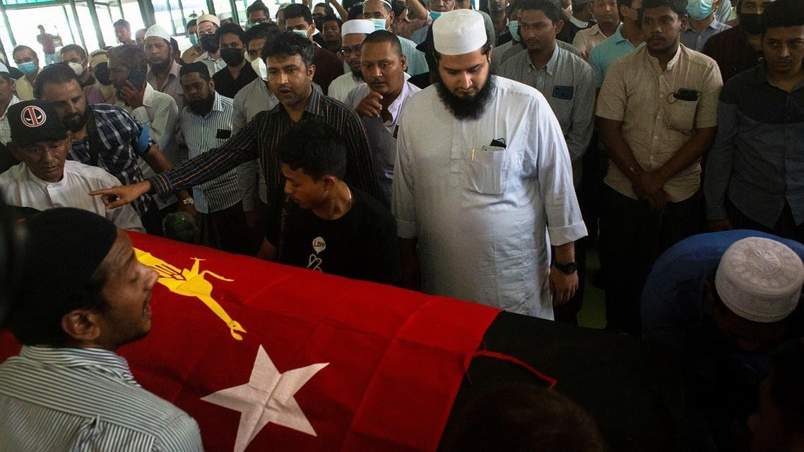 People attend at a funeral of Khin Maung Latt, 58, a National League for Democracy (NLD)'s ward chairman in Yangon, Myanmar March 7, 2021. (Reuters/Stringer)