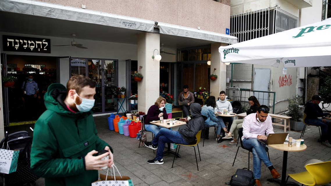Guests sit and take away food and drinks from a cafe in Tel Aviv. (Reuters)