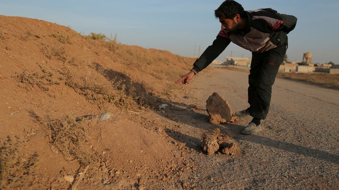 A resident points to what he said was a land mine, in the village of al-Heesha in Raqqa district after it was captured from Islamic State, north of Raqqa city, Syria November 15, 2016. REUTERS/Rodi Said