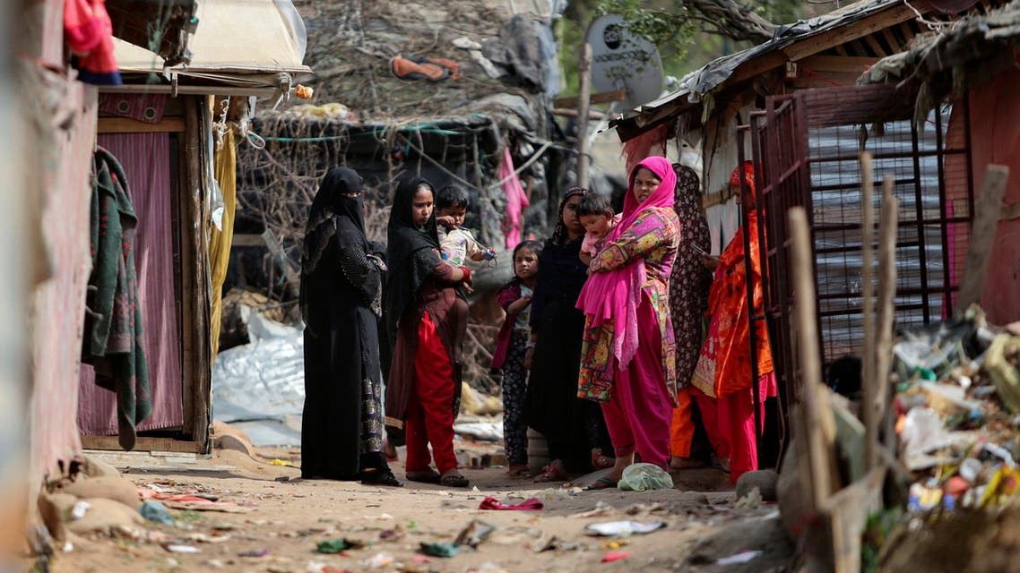Rohingya refugees stand outside their makeshift camp on the outskirts of Jammu, India, Sunday, March 7, 2021. (AP)