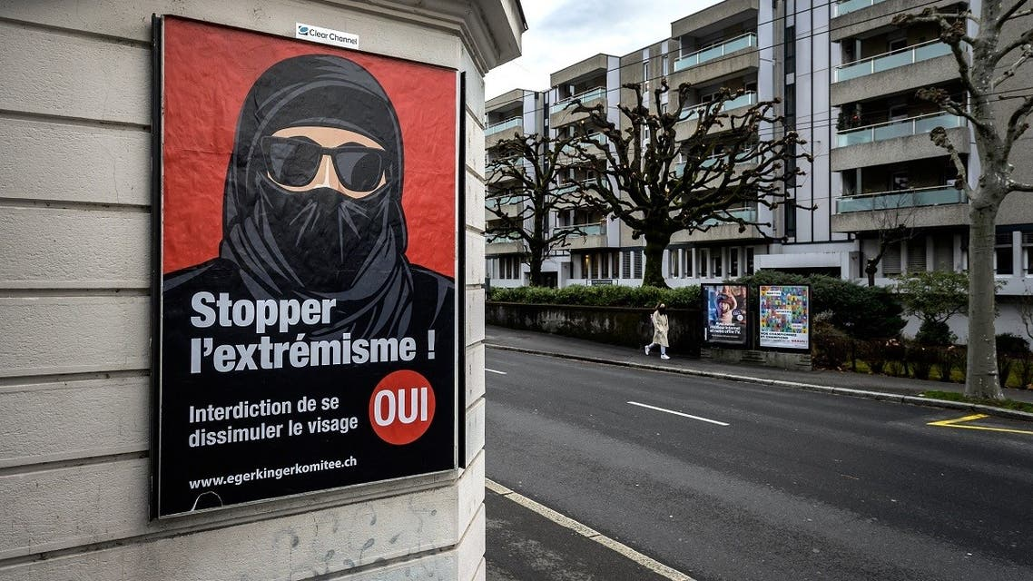 "A picture taken on February 4, 2021 in Lausanne shows an electoral poster in favor of a ""burqa ban"" initiative reading in French: ""Stop extremism!"" (Fabrice Coffrini/AFP)"
