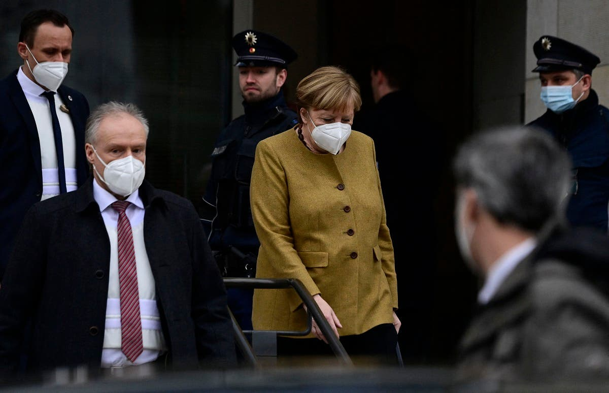 German Chancellor Angela Merkel (C) leaves the Reichstag building, seat of the German lower house of parliament Bundestag, during a session in Berlin on March 4, 2021. (Tobias Schwarz/AFP)